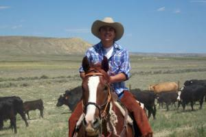 Young adult on a horse during addiction rehab.