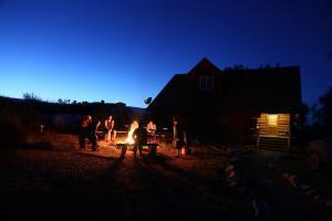 Young men around campfire